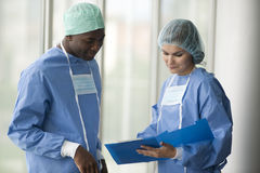 Surgeons consulting Stock Image