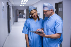 Surgeons discussing over digital tablet Stock Images
