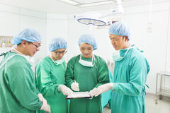 Surgeons discussing about something in operating theater Stock Photo
