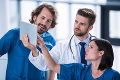 Surgeons and doctor looking at digital tablet Stock Photography