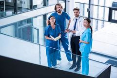 Surgeons, doctor and nurse standing in hospital Royalty Free Stock Photography
