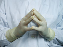 Surgeons hands. Surgeon's hands waiting for the preparation of the surgical field Royalty Free Stock Photos