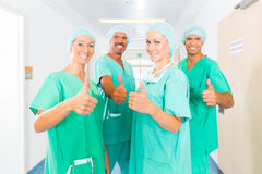Surgeons in Hospital or clinic as team. Hospital - medical surgery team is ready for the operation, the women and men wearing scrubs in a clinic stock photos