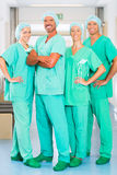 Surgeons in Hospital or clinic as team. Hospital - medical surgery team is ready for the operation, the women and men wearing scrubs in a clinic stock photo