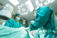 Surgeons inside operating theater Royalty Free Stock Photo
