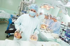 Surgeons nurse at cardiac surgery operation Stock Images