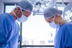 Surgeons performing operation in operation theater. At hospital Stock Image