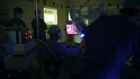 Surgeons performing an operation stock video footage