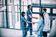 Surgeons shaking hands with each other Royalty Free Stock Image