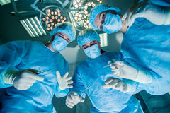 Surgeons standing above of the patient before Royalty Free Stock Image