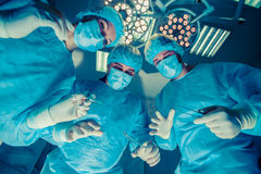 Surgeons standing above of the patient before surgery Royalty Free Stock Photo