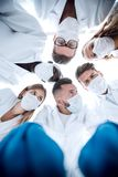 Surgeons standing above of the patient before surgery stock image
