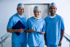 Surgeons standing in hospital corridor Stock Photo