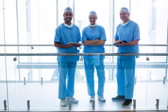 Surgeons standing in hospital corridor Royalty Free Stock Images