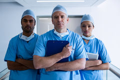 Surgeons standing in hospital corridor Royalty Free Stock Photography
