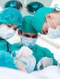 Surgeons during a surgery Stock Photo