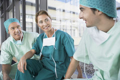 Surgeons Talking In Corridor At Break Royalty Free Stock Images