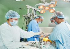 Surgeons team at cardiac surgery operation. Team of surgeon in uniform perform heart transplantation operation on a patient at cardiac surgery clinic royalty free stock photography