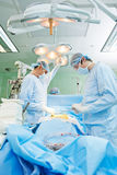Surgeons team at cardiac surgery operation. Team of surgeon in uniform perform heart transplantation operation on a patient at cardiac surgery clinic stock photos