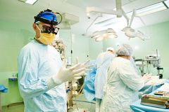 Surgeons team at cardiac surgery operation. Surgeons in uniform during heart transplantation operation on a patient at cardiac surgery clinic stock photography