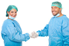 Surgeons team handshake Royalty Free Stock Photography