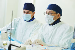 Surgeons team at vascular surgery operation Stock Images