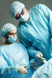 Surgeons at work Royalty Free Stock Images