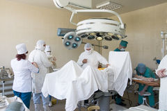 Surgeons at work Stock Photo