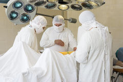 Surgeons at work Stock Images