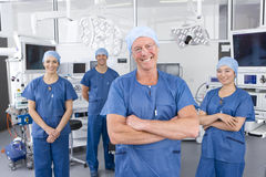 Surgeons working in hospital operating room Stock Photos
