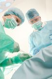 Surgeons working together Stock Photography