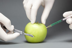 Surgery on an apple Stock Image