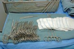 Surgery Instruments Setup. A real surgery instruments setup. Focus = row of white gauze. 12MP camera Stock Photography