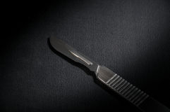 Surgery knife black plate. stock image