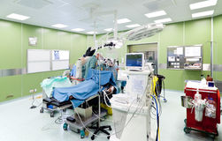 Surgery in operating room. Medical team performing surgery in operative room Stock Image