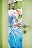 Surgery operation. Surgeon in uniform perform operation on a patient at cardiac surgery clinic Royalty Free Stock Photo