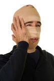Surgery Patient. A man wearing tensor bandages on his face Stock Photo