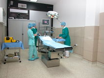 Surgery room. Three doctors preparing for an operation Stock Images