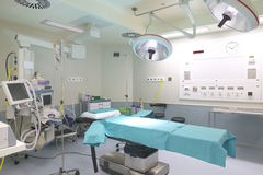 Surgery room with bed and machinery. Surgery room with bed an machinery. Horizontal Royalty Free Stock Photo