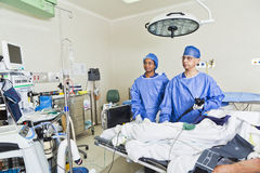 Surgery room with surgeon and nurses Stock Photo