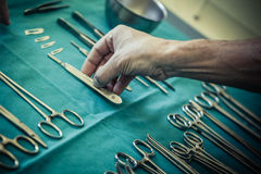 Surgery. Surgical instruments and tools including scalpels, forceps and tweezers arranged on a table for a surgery Stock Photography