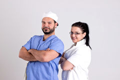Surgery Team of Doctor Woman and Surgeon. Couple of Young Surgeons Isolated on White Background Stock Photo