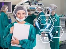 Surgery team with futuristic healthcare icons royalty free stock photography