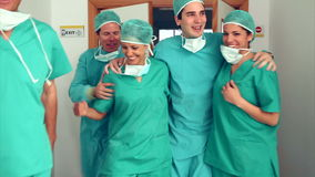 Surgery team leaving the operating room. In hospital