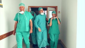 Surgery team leaving the operating room Stock Photography