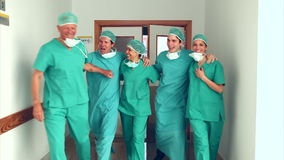 Surgery team leaving the operating room stock footage