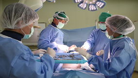 Surgery team operate stock video footage