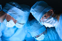 Surgery team in the operating room Stock Images