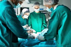 Surgery. Team operating in a surgical room Royalty Free Stock Photo