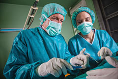 Surgery Team Operating. In A Surgical Room Stock Image